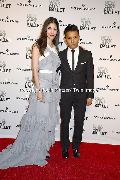 Carolyn Issau and Prabal Gurung attends the New York City Ballet Spring 2014 Gala on May 8, 2014 at David Koch Theatre in Lincoln Center in New York City, NY, USA.