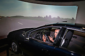 United States President Barack Obama sits behind the wheel of a driving simulator while touring the Federal Highway Administration's Turner-Fairbank Highway Research Center July 15, 2014 in McLean, Virginia. According to the Department of Transportation, the center is home to '20 laboratories, data centers, and support facilities, and conducts applied and exploratory advanced research in vehicle-highway interaction, nanotechnology, and a host of other types of transportation research in safety, pavements, highway structures and bridges, human-centered systems, operations and intelligent transportation systems, and materials.'  <br /> Credit: Chip Somodevilla / Pool via CNP