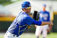 Burlington Royals catcher Cameron Gallagher #35 makes a throw to first base during practice at Burlington Athletic Park on June 15, 2012 in Burlington, North Carolina.  (Brian Westerholt/Four Seam Images)