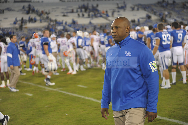 Head Coach Joker Phillips walks off the field after the University of Kentucky football game against Florida at Commonwealth Stadium in Lexington, Ky., on 9/24/11. UK lost the game 10-48. Photo by Mike Weaver | Staff