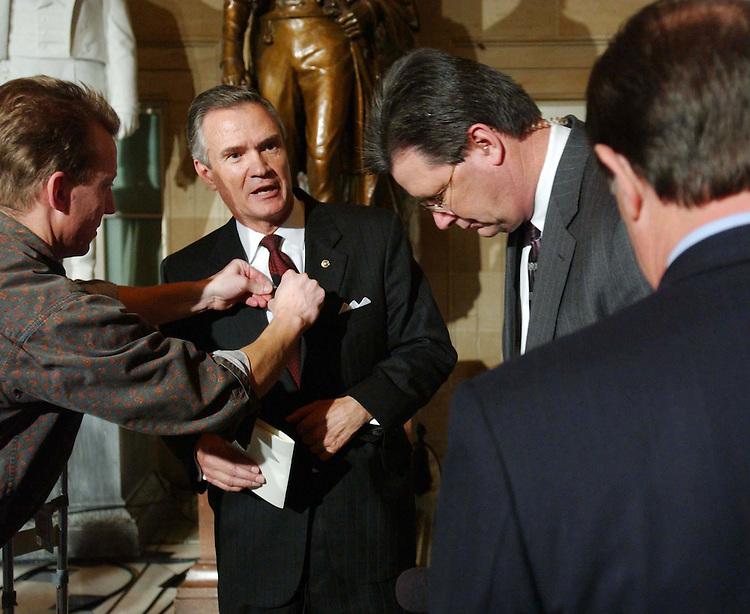 1/20/04.STATE OF THE UNION ADDRESS--After being interviewed on Fox in Statuary Hall, Sen. John B. Breaux, D-La., talks with House Majority Leader Tom DeLay, R-Texas, who is next in line, after the State of the Union address by President George W. Bush. .CONGRESSIONAL QUARTERLY PHOTO BY SCOTT J. FERRELL