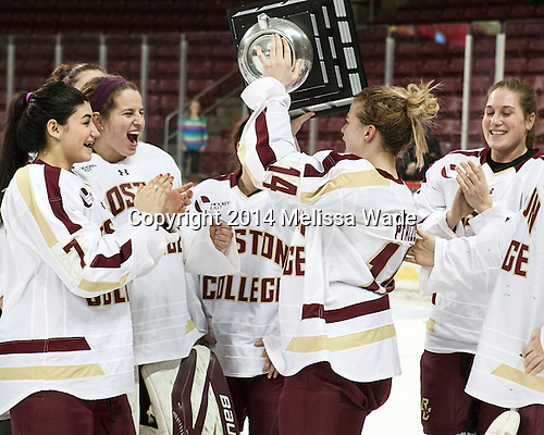 Kristyn Capizzano (BC - 7), Taylor Blake (BC - 35), Emily Pfalzer (BC - 14), Erin Kickham (BC - 3) - The Boston College Eagles celebrate winning the 2014 Beanpot championship on Tuesday, February 11, 2014, at Kelley Rink in Conte Forum in Chestnut Hill, Massachusetts.