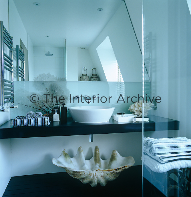 This attic bathroom has been decorated with objects from the seashore