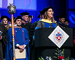 Misty M. Johanson, associate dean, serves as the university marshal Sunday, June 11, 2017, during the DePaul University Driehaus College of Business commencement ceremony at the Allstate Arena in Rosemont, IL. (DePaul University/Jamie Moncrief)