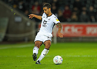 23rd November 2019; Liberty Stadium, Swansea, Glamorgan, Wales; English Football League Championship, Swansea City versus Millwall; Kyle Naughton of Swansea City brings the ball forward during the match - Strictly Editorial Use Only. No use with unauthorized audio, video, data, fixture lists, club/league logos or 'live' services. Online in-match use limited to 120 images, no video emulation. No use in betting, games or single club/league/player publications
