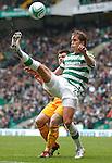 Thomas Rogne hoofs the ball overv the head of Steve Jennings