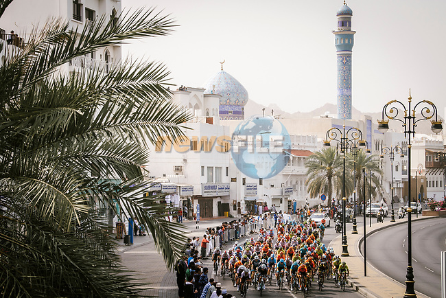 The peloton during Stage 6 of the 10th Tour of Oman 2019, running 135.5km from Al Mouj Muscat to Matrah Corniche, Oman. 21st February 2019.<br /> Picture: ASO/P. Ballet | Cyclefile<br /> All photos usage must carry mandatory copyright credit (© Cyclefile | ASO/P. Ballet)