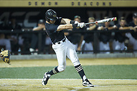 Chris Lanzilli (24) of the Wake Forest Demon Deacons follows through on his swing against the Virginia Cavaliers at David F. Couch Ballpark on May 18, 2018 in  Winston-Salem, North Carolina.  The Cavaliers defeated the Demon Deacons 15-3.  (Brian Westerholt/Four Seam Images)
