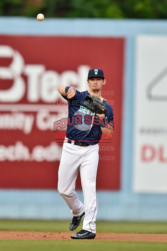 Beer City Tourists shortstop Brendan Rodgers (1) warms up between innings during a game against the  Greenville Drive at McCormick Field on June 2, 2016 in Asheville, North Carolina. The Drive defeated the Tourists 5-2. (Tony Farlow/Four Seam Images)