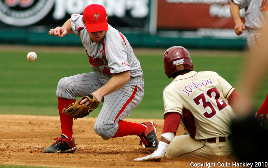 TALLAHASSEE, FL 3/28/10-FSU-MARY BASE10 CH-Florida State's Sherman Johnson slides safe at second as  Maryland's David Poutier can only watch as the throw coming to him takes a bad hop during action Sunday at the Dick Howser Stadium in Tallahassee. The Seminoles beat the Terrapins 9-5...COLIN HACKLEY PHOTO