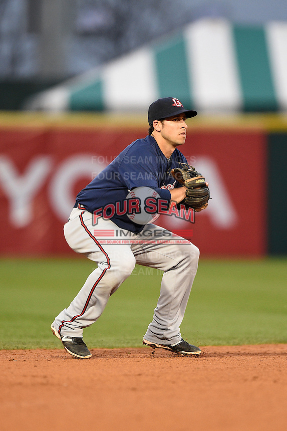 Gwinnett Braves shortstop Sean Kazmar (9) gets ready to field a ground ball during a game against the Buffalo Bisons on May 13, 2014 at Coca-Cola Field in Buffalo, New  York.  Gwinnett defeated Buffalo 3-2.  (Mike Janes/Four Seam Images)