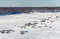 A teams runs on Long Lake amongst the crowds during the Official Re-Start of the 2018 Iditarod Sled Dog Race in Willow, Alaska on March 04, 2018.  The Alaska Range in the background<br /> <br /> Photo by Jeff Schultz/SchultzPhoto.com  (C) 2018  ALL RIGHTS RESERVED