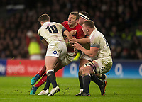 Wales' Hadleigh Parkes is tackled by Englands' George Ford and Sam Underhill<br /> <br /> Photographer Bob Bradford/CameraSport<br /> <br /> NatWest Six Nations Championship - England v Wales - Saturday 10th February 2018 - Twickenham Stadium - London<br /> <br /> World Copyright &copy; 2018 CameraSport. All rights reserved. 43 Linden Ave. Countesthorpe. Leicester. England. LE8 5PG - Tel: +44 (0) 116 277 4147 - admin@camerasport.com - www.camerasport.com