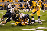University of Pittsburgh linebacker Jemeel Brady #24 forces a fumble by West Virginia Quarterback Jarrett Brown (on the ground) as brothers Scott McKillop #40 and Chris McKillop #41 close in.  Brown was able to recover the fumble but the Panthers still went on to upset the WVU Mountaineers 13-9 in the 100th edition of the Backyard Brawl played on 12-01-07 at Milan Puskar Stadium, Morgantown, West Virginia.