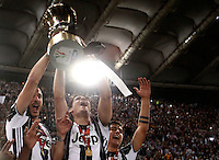 Calcio, finale Tim Cup: Milan vs Juventus. Roma, stadio Olimpico, 21 maggio 2016.<br /> From left, Juventus&rsquo;s Leonardo Bonucci, Alvaro Morata and Paulo Dybala hold the trophy at the end of the Italian Cup final football match between AC Milan and Juventus at Rome's Olympic stadium, 21 May 2016. Juventus won 1-0 in the extra time.<br /> UPDATE IMAGES PRESS/Isabella Bonotto