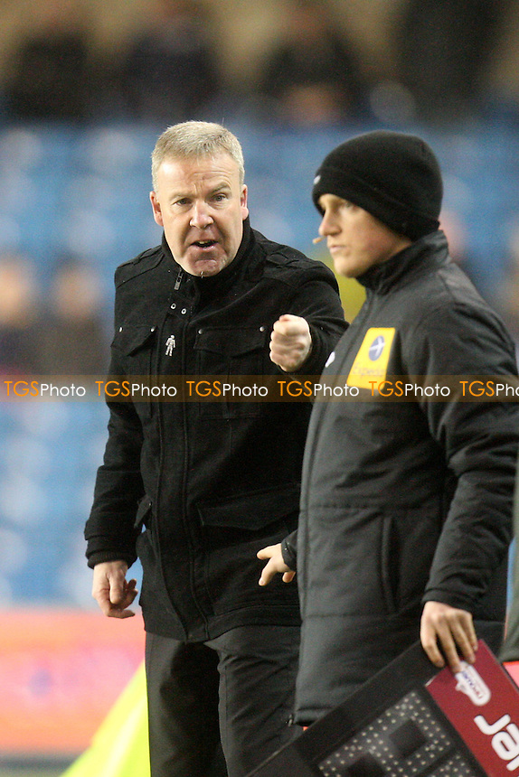 Millwall manager Kenny Jackett questions the fourth official over an incident - Millwall vs Sheffield Wednesday at the New Den Stadium - 09/04/13 - MANDATORY CREDIT: Dave Simpson/TGSPHOTO - Self billing applies where appropriate - 0845 094 6026 - contact@tgsphoto.co.uk - NO UNPAID USE.