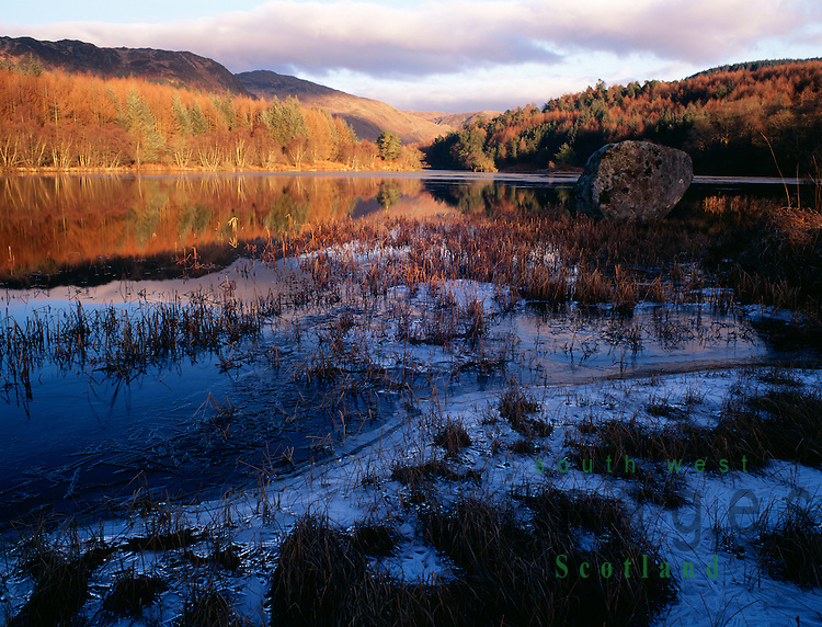 Scottish winter landscape a frozen Loch Trool looking up Glen Trool to the Fells of Eschoncan in the Galloway Forest Park Scotland UK