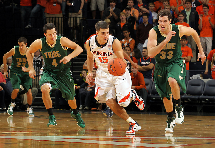 Nov. 12, 2010; Charlottesville, VA, USA;  Virginia Cavaliers guard Billy Baron (15) breaks away from William & Mary Tribe guard Matt Rum (4) and William & Mary Tribe forward JohnMark Ludwick (33) after stealing the ball during the game at the John Paul Jones Arena. Virginia won 76-52.  Mandatory Credit: Andrew Shurtleff-