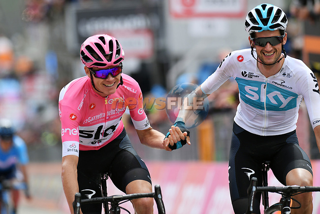 Job done race leader Chris Froome (GBR) and team mate Wout Poels (NED) Team Sky cross the finish line of Stage 20 of the 2018 Giro d'Italia, running 214km from Susa to Cervinia is the final mountain stage, with the last three climbs of Giro 101 deciding the GC of the Corsa Rosa, Italy. 26th May 2018.<br /> Picture: LaPresse/Gian Mattia D'Alberto | Cyclefile<br /> <br /> <br /> All photos usage must carry mandatory copyright credit (© Cyclefile | LaPresse/Gian Mattia D'Alberto)