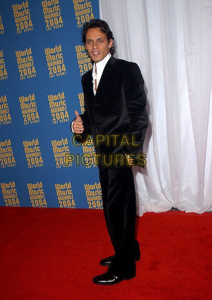 MARC ANTHONY - MARK.15th Annual World Music Awards held at The Thomas & Mack Center in Las Vegas, Nevada .September 15,2004.full length, thumbs up, hand gesture, black suit, hand in pocket.www.capitalpictures.com.sales@capitalpictures.com. Copyright 2004 by Debbie VanStory