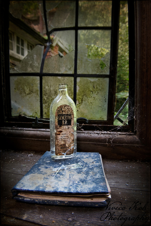 Empty glycerin bottle on book