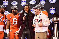 Charlotte, NC - DEC 2, 2017: Clemson Tigers head coach Dabo Swinney is interviewed by ESPN's Maria Taylor after winning the ACC Championship game over Miami 38-3 at Bank of America Stadium Charlotte, North Carolina. (Photo by Phil Peters/Media Images International)