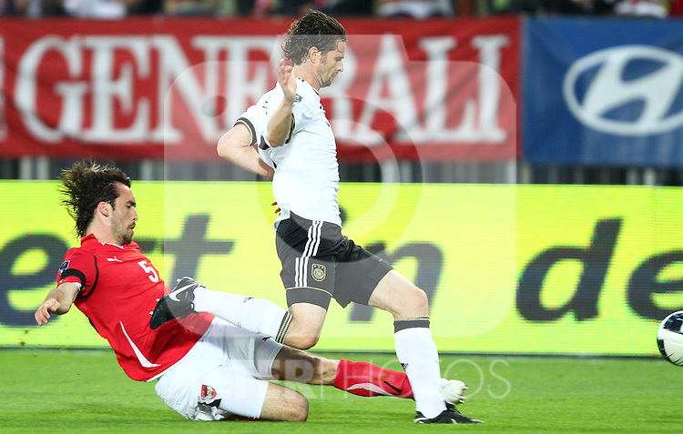 03.06.2011, Ernst Happel Stadion, Wien, AUT, UEFA EURO 2012, Qualifikation, Oesterreich (AUT) vs Deutschland (GER), im Bild Zweikampf zwischen Christian Fuchs, (AUT, #5) und Arne Friedrich, (GER, #3)  // during the UEFA Euro 2012 Qualifier Game, Austria vs Germany, at Ernst Happel Stadium, Vienna, 2010-06-03, EXPA Pictures © 2011, PhotoCredit: EXPA/ T. Haumer