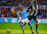 30th November 2019; St James Park, Newcastle, Tyne and Wear, England; English Premier League Football, Newcastle United versus Manchester City; Fernandinho of Manchester City turns away from Jetro Willems of Newcastle United - Strictly Editorial Use Only. No use with unauthorized audio, video, data, fixture lists, club/league logos or 'live' services. Online in-match use limited to 120 images, no video emulation. No use in betting, games or single club/league/player publications