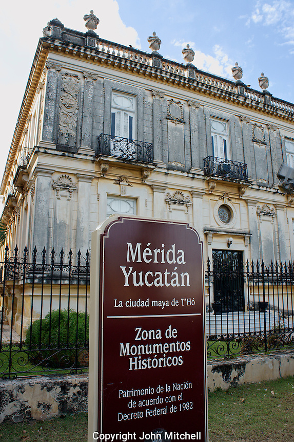Historical monuments Sign in front of one of the Casa de Gemelas or Twins Houses on Paseo de Montejo in Merida, Yucatan, Mexico.