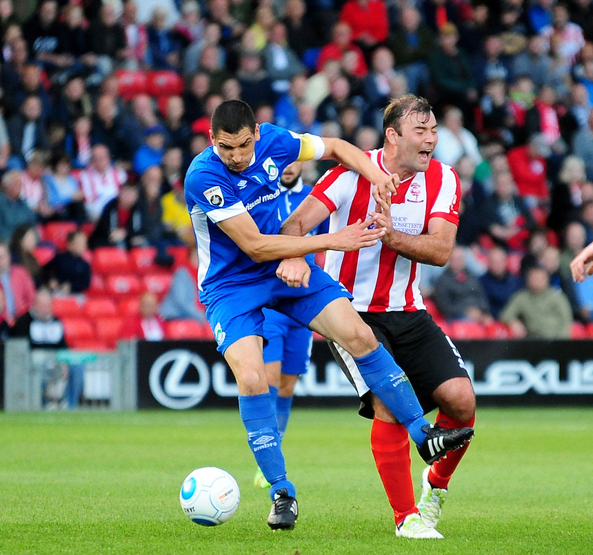 North Ferriby United's Jake Skelton vies for possession with Lincoln City's Matt Rhead<br /> <br /> Photographer Andrew Vaughan/CameraSport<br /> <br /> Football - Vanarama National League - Lincoln City v North Ferriby United - Tuesday 9th August 2016 - Sincil Bank - Lincoln<br /> <br /> &copy; CameraSport - 43 Linden Ave. Countesthorpe. Leicester. England. LE8 5PG - Tel: +44 (0) 116 277 4147 - admin@camerasport.com - www.camerasport.com