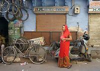 street scene with woman in red sari  in Jodhpur, Rajastan, India