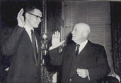 This is a photo of Sam Rayburn swearing in 29-year-old John Dingell on Dec. 13, 1955.