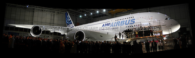1/18/2004--Toulouse, France..The first Airbus A380 super jumbo is unveiled to the public at a huge ceremony held in the south of France attended by British Prime Minister Tony Blair, French President Jacques Chirac, Spanish Prime Minister Jose Luis Rodriguez Zapatero and German Chancellor Gerhard Schroeder.  Due to enter service in 2006, the A380 will replace the Boeing 747 jumbo as the world's biggest passenger aircraft; the 555 seat A380-800, with a non-stop range of 8,000 nautical miles, was launched in December 2000. The aircraft entered production in January 2002. The first flight (with the Rolls-Royce engines) is scheduled for March, 2005 and entry into service for early 2006. ..Airbus's double-decker passenger jet will be the largest airliner ever built. In a one-class configuration, the A380 could accommodate as many as 840 passengers. The more likely three-class configuration will still offer an unprecedented 555 passenger seats. The A380 would offer 30% - 50% more seating than its direct competition, the Boeing 747-400...European aircraft maker Airbus launched production of its A380 ?superjumbo,? the biggest ever commercial airliner, stepping up its challenge to U.S. rival Boeing Co. which has staked its future on a new mid-sized jet...Photograph by Stuart Isett.©2004 Stuart Isett. All rights reserved