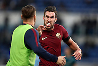 Calcio, Serie A: Lazio vs Roma. Roma, stadio Olimpico, 4 dicembre 2016.<br /> Roma&rsquo;s Kevin Strootman, right, celebrates with teammate Francesco Totti after scoring during the Italian Serie A football match between Lazio and Rome at Rome's Olympic stadium, 4 December 2016. Roma won 2-0.<br /> UPDATE IMAGES PRESS/Isabella Bonotto