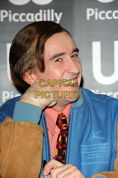 Steve Coogan aka Alan Partridge .At a book signing at Waterstone's, Piccadilly, London, England..October 4h, 2011.headshot portrait blue jacket pink salmon shirt tie smiling hand latex glove.CAP/CJ.©Chris Joseph/Capital Pictures.