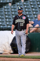 Kane County Cougars coach Chris Gutierrez (12) during a game against the Peoria Chiefs on June 2, 2014 at Dozer Park in Peoria, Illinois.  Peoria defeated Kane County 5-3.  (Mike Janes/Four Seam Images)