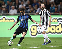 Calcio, Serie A: Inter - Juventus, Milano, stadio Giuseppe Meazza (San Siro), 28 aprile 2018.<br /> Intro's Antonio Candreva (l) in action with Juventus' Miralem Pjanic (r) during the Italian Serie A football match between Inter Milan and Juventus at Giuseppe Meazza (San Siro) stadium, April 28, 2018.<br /> UPDATE IMAGES PRESS/Isabella Bonotto