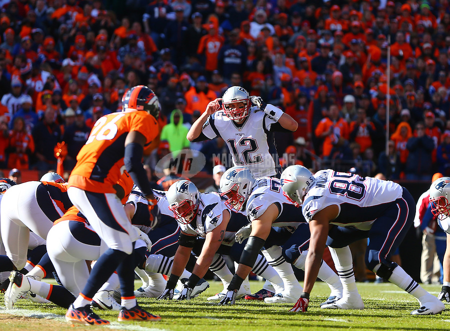 Jan 24, 2016; Denver, CO, USA; New England Patriots quarterback Tom Brady (12) reacts against the Denver Broncos in the AFC Championship football game at Sports Authority Field at Mile High. Mandatory Credit: Mark J. Rebilas-USA TODAY Sports