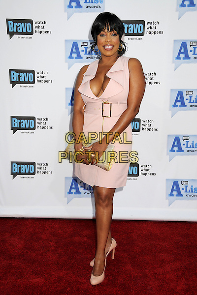 "NIECY NASH.Bravo's 2nd Annual ""The A-List Awards"" held at The Orpheum Theatre, Los Angeles, CA, USA..April 5th, 2009.full length clutch bag buckle belt sleeveless plunging neckline pink cleavage gold hoop earrings beige .CAP/ADM/BP.©Byron Purvis/AdMedia/Capital Pictures."