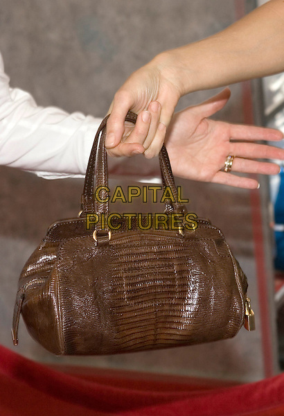 "KELLY PRESTON'S PURSE.Walt Disney Pictures' World Premiere of ""Sky High"" held at the El Capitan Theatre, Hollywood, California..July 24th, 2005  .Photo Credit: Zach Lipp/AdMedia.bag purse brown leather.www.capitalpictures.com.sales@capitalpictures.com.© Capital Pictures."