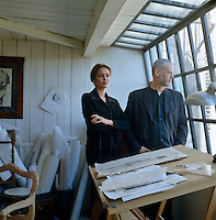 Portrait of designer Asli Tunca and her sculptor husband Carl Vercauteren in their studio at the top of the house