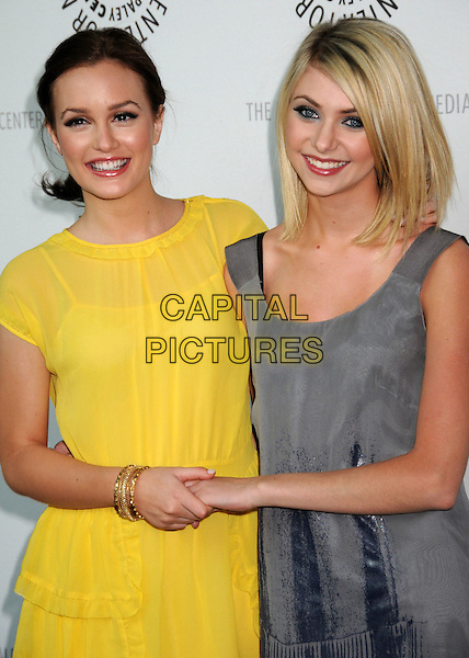 """LEIGHTON MEESTER & TAYLOR MOMSEN .The 25th Annual Paley TV Festival Presents """"Gossip Girl"""" at Arclight Cinemas, Hollywood, California, USA, .22 March 2008..half length yellow dress grey holding hands .CAP/ADM/BP.©Byron Purvis/Admedia/Capital PIctures"""