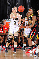 25 November 2011:  FIU guard Zsofia Labady (3) passes the ball in the first half as the University of Maryland Terrapins defeated the FIU Golden Panthers, 84-52, at the U.S. Century Bank Arena in Miami, Florida.