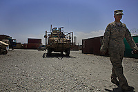 US ARMY Specialist Kahaya Komar walks her truck back to its parking area after overseeing its refueling after a mission at  Forward Operating Base Fenty in the outskirts of Jalalabad, Afghanistan on Thursday   May 6, 2010...Specialist Komar is a radio operator and assistant gunner on logistical convoys with Destro Platoon, Fury Company, 2nd Battalion, 4th Brigade, Task Force Mountain Warrior, 4th Infantry Division..