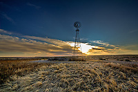 A windmill at sunset in the Cimarron National Grassland near Elkhart Kansas.