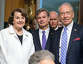United States Senator Charles Grassley (Republican of Iowa), Chairman, US Senate Committee on the Judiciary, right, and US Senator Dianne Feinstein (Democrat of California), Ranking Member, US Senate Committee on the Judiciary, left, pose for a photo with Christopher A. Wray, center, before he testifies on his nomination to be Director of the Federal Bureau of Investigation (FBI) before the Committee on Capitol Hill in Washington, DC on Wednesday, July 12, 2017.<br /> Credit: Ron Sachs / CNP<br /> (RESTRICTION: NO New York or New Jersey Newspapers or newspapers within a 75 mile radius of New York City)