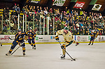 29 December 2013:  University of Vermont Catamount Forward Jake Fallon, a Junior from Southlake, Texas, takes a second shot against the Canisius College Golden Griffins at Gutterson Fieldhouse in Burlington, Vermont. The Catamounts defeated the Golden Griffins 6-2 to capture the 2013 Sheraton/TD Bank Catamount Cup NCAA Hockey Tournament for the second straight year. Mandatory Credit: Ed Wolfstein Photo *** RAW (NEF) Image File Available ***