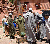 Shoppers inspect produce at a Sunday market in a small town east of the Tizi n Tichka Pass in the High Atlas mountains of Morocco.
