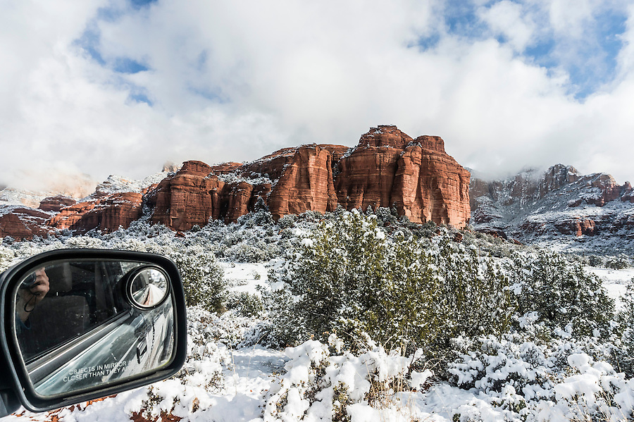 Snowfall in Sedona, AZ through side window of a car.
