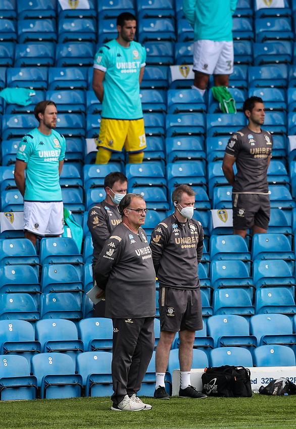 Leeds United manager Marcelo Bielsa, his staff and players observe a minute's silence for the late Jack Charlton<br /> <br /> Photographer Alex Dodd/CameraSport<br /> <br /> The EFL Sky Bet Championship - Leeds United v Barnsley - Thursday 16th July 2020 - Elland Road - Leeds<br /> <br /> World Copyright © 2020 CameraSport. All rights reserved. 43 Linden Ave. Countesthorpe. Leicester. England. LE8 5PG - Tel: +44 (0) 116 277 4147 - admin@camerasport.com - www.camerasport.com